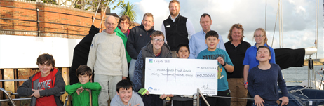 Community Links crew receive the donation from Marina Developments Limited to OYT South